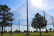 This photo provided by Kansas State University Polytechnic Campus shows the school's new drone testing pavilion for unmanned aircraft systems (UAS). The nets on the 300-foot long, 200-foot wide and 50-foot tall structure allow the wind, rain, snow or other weather conditions to easily pass into the test area and don't block GPS signals. That means that researchers can test the drones in lifelike situations without risking safety.