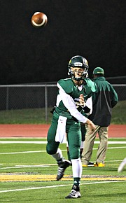 Justin Phillips threw two touchdown passes against Louisburg on Friday.