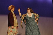 Hannah Scheck (right), playing Miss Hannigan, scolds Annie, played by Heidi Rodgers, during Monday's performance for elementary school students.