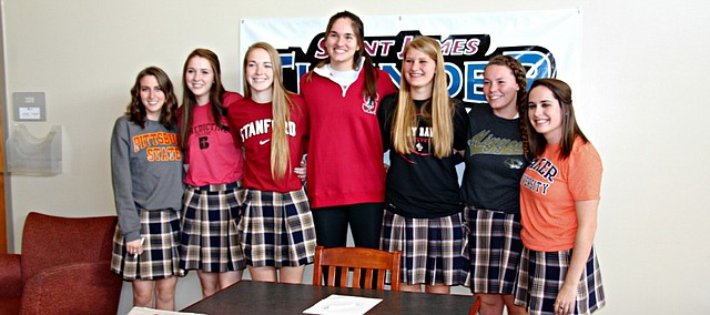 From left: St. James student-athletes Taylor Nill, Mackenzie Kraft, Jenna Gray, Audriana Fitzmorris, Kayla Staley, Allie Webb and Alanna Dierking signed their letters of intent on Wednesday.