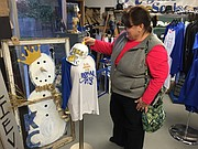 Angie Bensouda takes a peek at some merchandise at ShananiGanns, 12208 Johnson Drive.