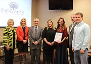 Members of the Shawnee Chamber of Commerce stand with several small business owners in Shawnee and accept Mayor Michelle Distler's declaration that the Saturday after Thanksgiving be Small Business Saturday.