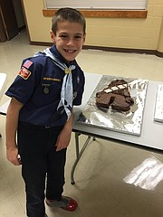 Joshua Mackiewicz, 8, stands in front of his Chewbacca cake, which took home the prize for best Star Wars cake.