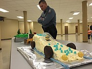 Shawnee Police Chief Rob Moser looks over the entries in this year's Cake Bake Competition held by the local Boy Scout Troop 3284.