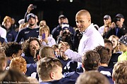 Mill Valley coach Joel Applebee talks to his team after they beat St. Thomas Aquinas on Friday night.