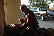 BLAS volunteer Jeff Bohndorf sorts through food donated to the food pantry Nov. 13.