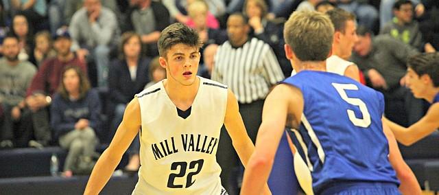 Mill Valley senior Kasey Conklin (22) defends against Gardner-Edgerton.