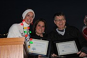 Mayor Michelle Distler presented Kriste Everett with a Good Neighbor Award and Robbie Marts with a key to the city on Dec. 5.