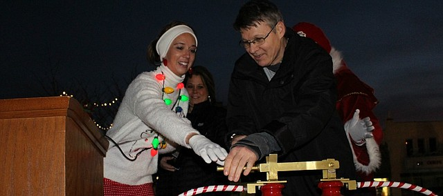 Mayor Michelle Distler helps Robbie Marts flip the switch for the Mayor's Christmas Tree at the lighting event on Dec. 5.