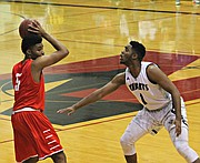 Marcus Weathers (5) scored 18 points against Barstow.