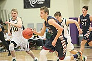 St. James' Will McKee (13) dribbles up the court against O'Hara on Wednesday night.