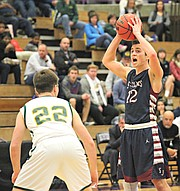 St. James' Zach Wagner (12) looks to pass against O'Hara on Wednesday night.