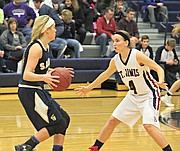 Ali Burke (4) defends against St. Thomas Aquinas.