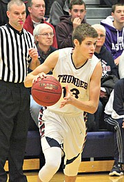 Will McKee dribbles around a pick against St. Thomas Aquinas.