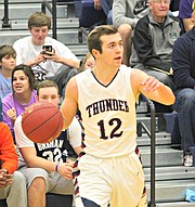 Zach Wagner tries to get St. James set up on offense against St. Thomas Aquinas.