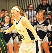 Mill Valley's Catie Kaifes defends against Basehor-Linwood.