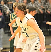 Mill Valley's Cooper Kaifes defends against Basehor-Linwood.