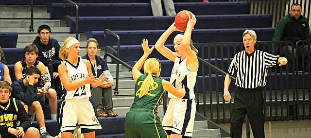 Mill Valley's Evan Zars (24) looks to pass while being defended by Basehor-Linwood's Nicole Rutherford (33)