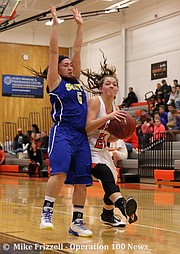 Northwest junior Emmalee Rose (21) faced strong defense from Olathe South junior Makayla Gooch (5) most of the game.