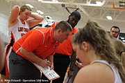 Northwest coach Tyler Stewart draws out a play for his team during a timeout.