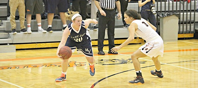 Mill Valley's Catie Kaifes (30) scored 16 points against Bonner Springs on Friday night.