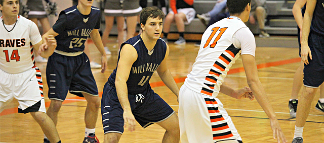 Logan Koch (4) scored 10 points in the first quarter for Mill Valley on Friday.