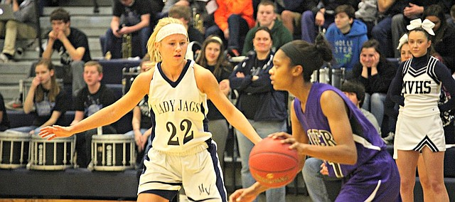 Mill Valley's Courtney Carlson (22) guards against Piper's Jessica Malone.