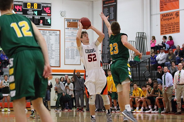 Shawnee Mission Northwest senior Dylan Dirks shoots a 3-pointer at the buzzer to try to force overtime Friday against SM South, but missed as the Cougars fell to the Raiders, 47-44. Dirks hit 4-of-7 3-pointers for 16 points to lead SMNW.
