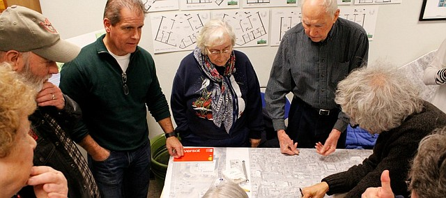 Shawnee City Councilman Dan Pflumm listens to residents during a workshop on Wednesday for the Nieman Road corridor reallocation project.