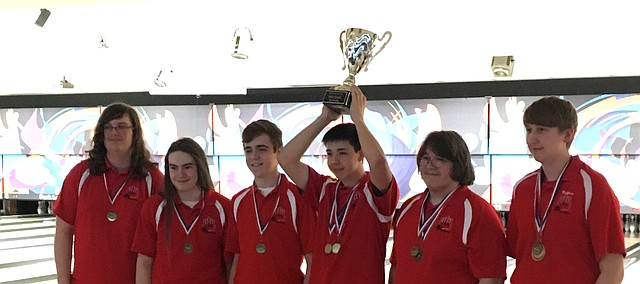 Shawnee Mission North bowler Travis Wunderlin lifts up the Shawnee Mission Boys Bowling District Championship trophy after leading the Indians to a first-place finish Wednesday at Park Lanes. Wunderlin won the individual title with a three-game series of 667. Pictured left to right are Daniel Johnson, Jack DeNebeim, Caleb Brooks, Wunderlin, Peter Hubenett and Matthew Webb.