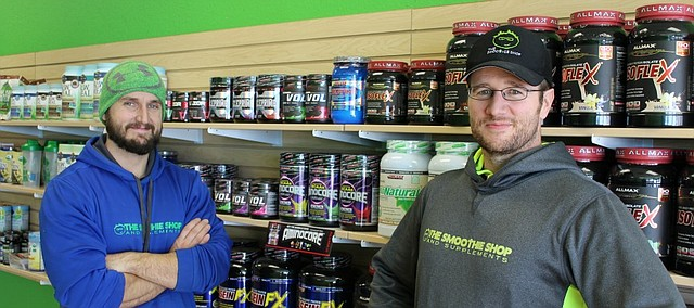 Owner Kevin Hourihan and his business partner Chuck Abele stand in their new Shawnee business, The Smoothie Shop.