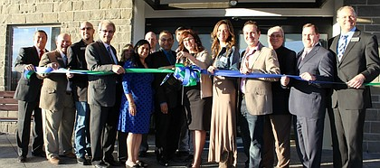 Holiday Inn Express of Shawnee General Manager Renee Hadley prepares to cut the ribbon for the new hotel in western Shawnee along with Mayor Michelle Distler and other representatives from the city of Shawnee and the ownership group of the hotel.