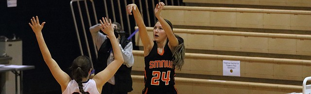 Shawnee Mission Northwest sophomore Jordann Nachbar follows through on a shot during the Cougars' 41-32 win Tuesday over Olathe East.