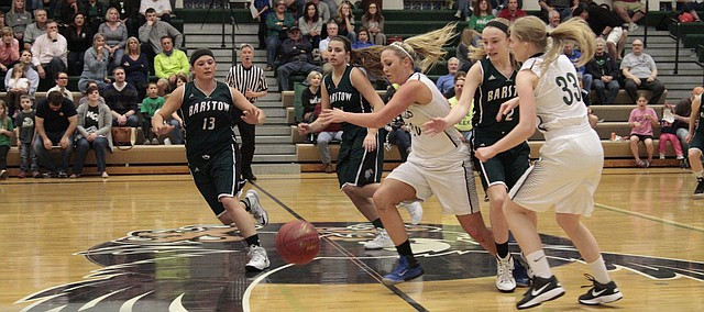 Maranatha Christian Academy senior Blythe Asbell (middle, No. 10) emerges out of a pack for a loose ball against Barstow in the 56-18 loss to the Knights, Friday. Asbell scored six points and pulled down four rebounds on her senior night.