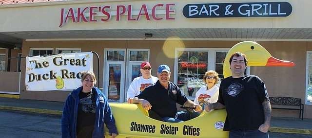 JJ Miller Jr. sits in the duck boat outside of Jake's Place Bar & Grill in Shawnee along with  Janine Lannell, Lee Shaffer of Hyper Computer and Battle Games, JJ Miller and Barb Miller. Miller Jr. drove the duck boar around to several Duck Race sponsors on Saturday.