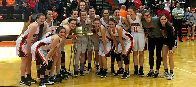 Shawnee Mission Northwest's girls basketball team celebrates a Class 6A sub-state championship after defeating Olathe Northwest, 58-39, Friday.