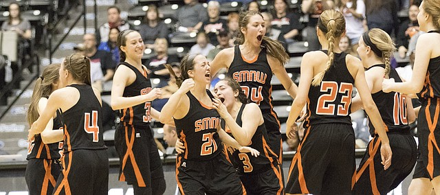 Members of Shawnee Mission Northwest's girls basketball team celebrate their 38-36 win over Olathe South in the Class 6A state semifinals Friday in Wichita.