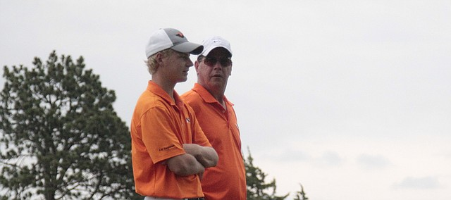 Shawnee Mission Northwest senior Blake Allen (left) listens to Cougar golf coach Jim Bamburg before teeing off on the 17th hole Monday at the Class 6A state tournament Monday at Manhattan Country Club.