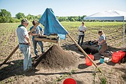 Chase Oswald (second from right) of Shawnee works at a dig site for the Kansas Archaeological Field School, run by Kansas State University.