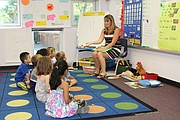 Katie Heier (right) goes over letters and sounds with her Jump Start students Friday at Bluejacket-Flint Elementary.