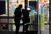 Shawnee officers look for fingerprints on the glass doors of the Walgreens store at 11830 W. 75th Street.