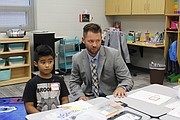 Shawanoe Elementary School principal Dominic Flora spent a few minutes on the first day of school chatting with first-grade student Erasmo Arano and his classmates.