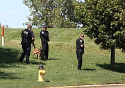 A Shawnee Police K-9 team and an Olathe officer searched the area for the second suspect.