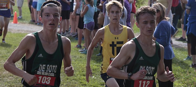 De Soto cross country runners Sam Hubert (left) and Kason Jackson (right) run side by side at the Greg Wilson Classic on Sept. 3 at Johnson County Community College. De Soto joined KC-Sumner Academy in moving up from Class 4A to 5A in the Kansas State High School Activities Association Monday.
