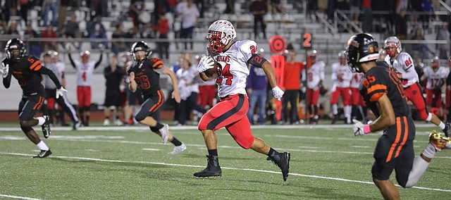 Shawnee Mission North senior running back Marcos Garcia breaks free for a long run up the middle in the Indians' 61-38 win over SM Northwest Friday at SM North District Stadium.