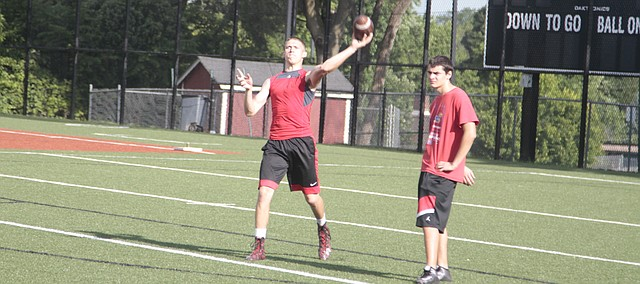 Shawnee Mission North senior quarterback Will Schneider throws a pass during a morning workout on June 16 at SM North District Stadium. Schneider broke the all-time state passing yards record Friday in the final game of his high school career.