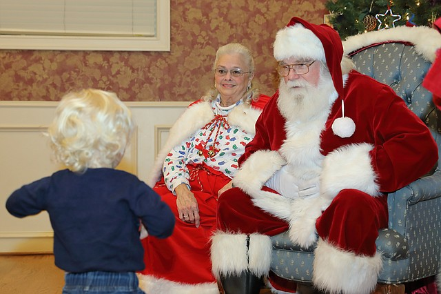 Santa and Mrs. Claus dropped by Shawnee Town Hall on Saturday evening to take photos with children. The line to meet with Jolly Old St. Nick and his wife was so long, it extended out the door.