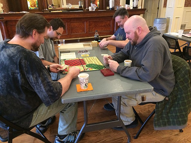 KC Board Games and Stuff Meet-Up members recently tested out a few 1920's board games at Shawnee Town 1929. They are: Tim Swiastyn, front left; Randall Wald, back left; Ross Durossette, back right; and Patrick Ballou, front right.
