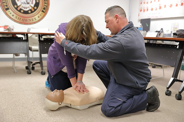 Shawnee firefighter Larry Beets helps a resident learn CPR during a training session on Saturday evening.