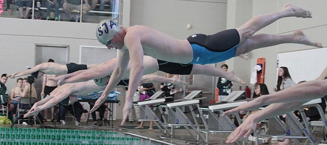 St. James Academy junior Nick Callahan dives into the pool during the 50-yard freestyle Saturday at Blue Valley Southwest at the Eastern Kansas League meet. Callahan finished second in the 50 and 100 freestyles.